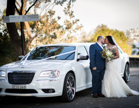 Wedding-couple-and-limousine